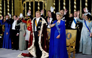 The Dutch King Willem being saluted by Queen Maxima and the other guests during the coronation.