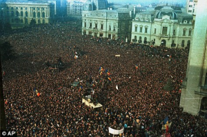 Thousands of protesters in Bucharest at the 1989 revolution to end up the regime.